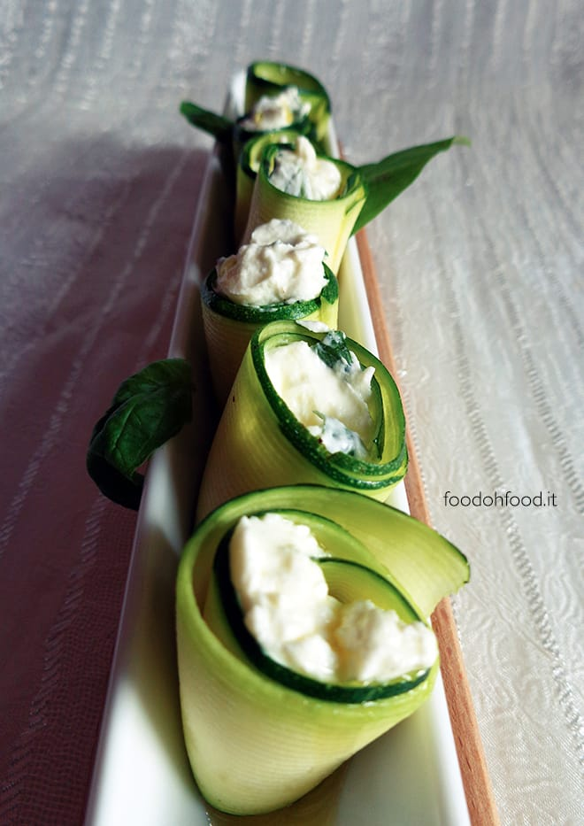 Raw zucchini rolls with cream cheese and nut filling