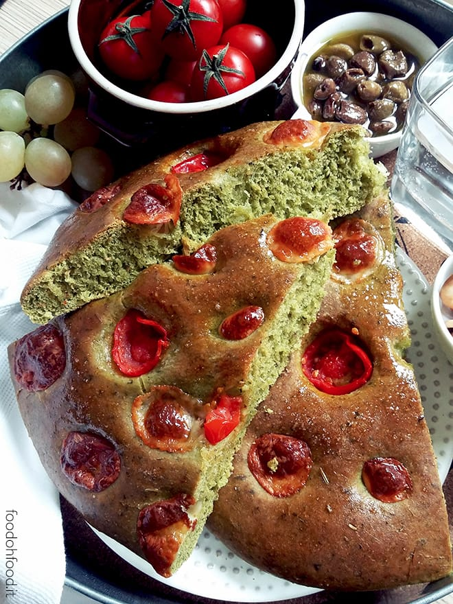 Green focaccia with cherry tomatoes and cheese