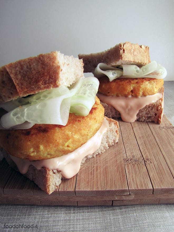 Cod burger with spicy sauce and cucumber