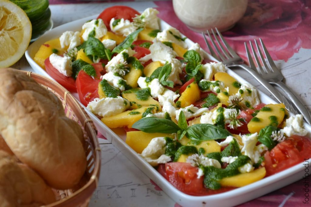 Summer peach and tomato caprese salad with basil sauce