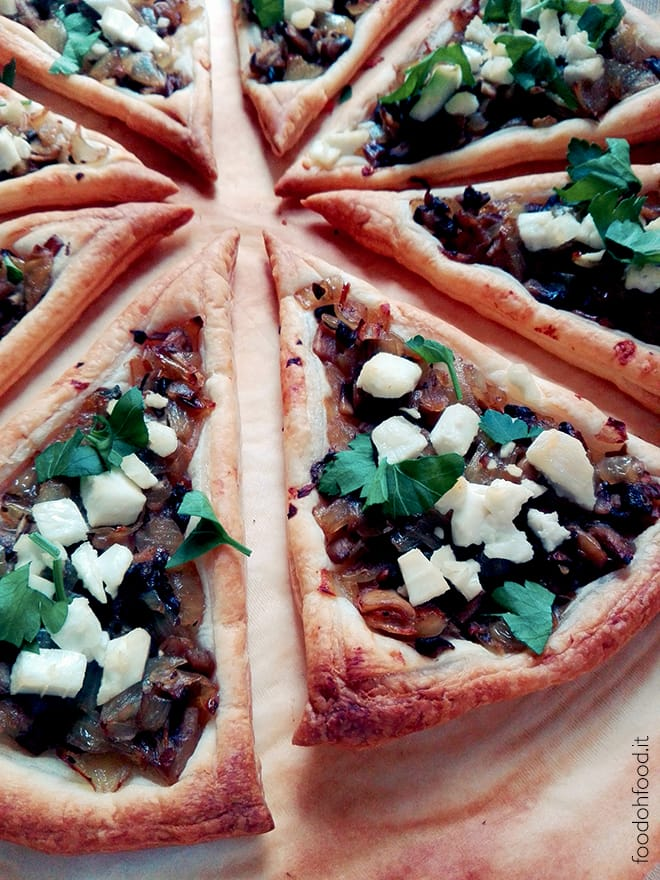 Puff pastry slices with caramelized onions, mushrooms and feta