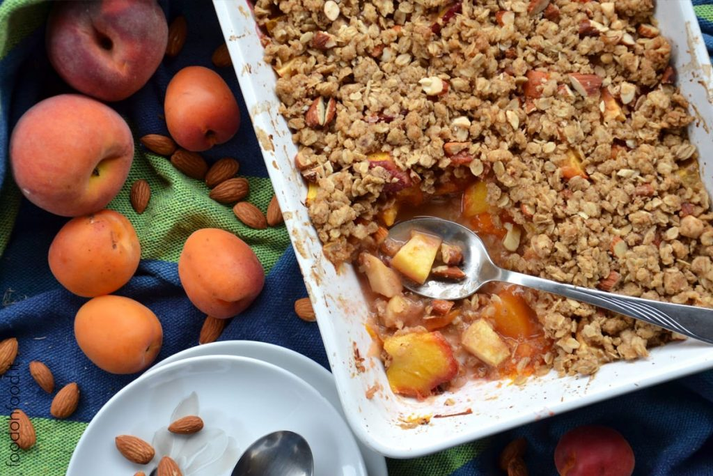 Peach and apricot crumble with oats and almonds